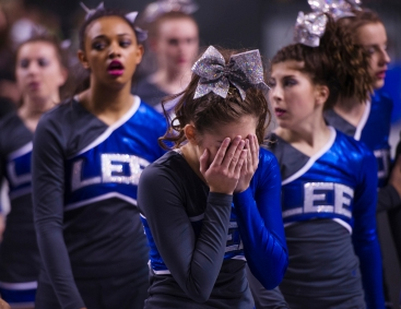 Robert E. Lee High School's Michelle Spencer walks off the competition mat with her face in her hands after falling during the school's final performance in the Group 2A cheerleading state championship in Richmond on Nov. 8, 2014.