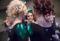 Wilson Memorial High School's Savannah Hull, center, talks with teammates before their Group 2A cheerleading state championship performance in Richmond on Nov. 8, 2014.