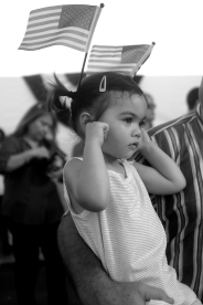 Adelynne MacKenzie, 2, plugs her ears as the U.S. Fllet Forces Band plays prior to the christening of the submarine John Warner SSN 785 Saturday evening at Newport News Shipbuilding.