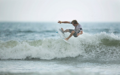 Brogie Panesi gets some air during his Men's Pro Heat at the 52nd Annual Coastal Edge East Coast Surfing Championships.
