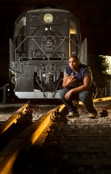 Schekel Wallace is the defensive football player of the year from Lafayette High. He is pictured with a RS-1 diesel locomotive. This train engine was used in WWII to move supplies over a railroad that ran from Persia to get supplies behind the lines to the Russians. This mission became especially important in the winter when Russian ports were frozen closed.