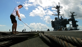 "York High's Connor Rinoski is the golf athlete of the year. Rinoski is teeing off from the deck of the USS Truman using the arresting cable. There are four of the heavy steel cables that snag the tailhook of the aircraft bringing it to a stop on the flight deck. An aircraft coming in to land ideally tries to snag the ""3 wire"" as it's referred to."