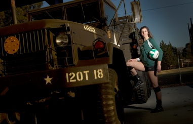 "Kelly Esch is the girls volleyball player on the year from Jamestown High. She is pictured with a two and a half ton Army M35 truck also known as the famous ""deuce and a half."" This beloved multipurpose vehicle has served in one form or another since WWII to transport supplies and men on the battlefield."