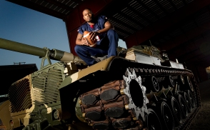 Terrence Dingle of Denbigh High is the offensive football player of the year. He is posing on an M60 Patton tank which entered service with the Army in the early 1960's. The M60 was the main battle tank of the Army until being replaced by the M1 Abrams. These tanks are still in use with militaries in Egypt, Israel and Turkey and were last used in combat my the Marines during Desert Storm.