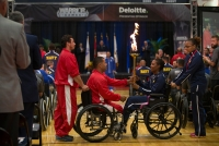 Marine Cpl. Jorge Salazar hands the torch to Navy Sonar Technician Surface 2nd Class Shericka Goza during the opening ceremony for the 2014 Warrior Games at the US Olympic Training Center in Colorado Springs, Colorado, on Sunday, September 28, 2014.
