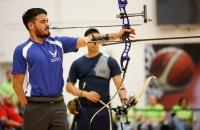 Air Force's Daniel Crane competes against Navy's Jonathan Adviento in the gold-medal match of the individual recurve archery competition at the 2014 Warrior Games in Colorado Springs, Colorado, on Wednesday, October 1, 2014. Adviento won the gold.