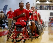 The Marine Corps wheelchair basketball team listens to the national anthem before taking on Army in the gold medal match. The Marines defeated Army for the gold medal at the 2014 Warrior Games in Colorado Springs, Colorado, on Friday, October 3, 2014.