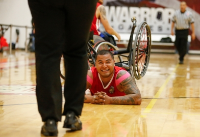 Staff Sgt. Jorge Salazar looks to a referee after falling during the Marine Corps-Army wheelchair basketball game at the 2014 Warrior Games on Wednesday, October 1, 2014. Marine Corps beat Army to remain undefeated.