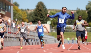 Air Force's Nicholas Dadgostar crosses the finish line in the 100-meter dash open at the 2014 Warrior Games at Garry Berry Stadium in Colorado Springs, Colorado, on Thursday, October 2, 2014.