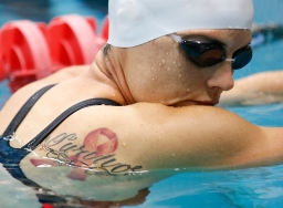 Air Force Tech. Sgt. Lara Ishakawa warms up in the pool before the start of the championship swim events at the 2014 Warrior Games at the US Olympic Training Center in Colorado Springs, Colorado, on Tuesday, September 30, 2014.