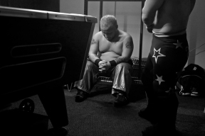Jacob Brooks, Lil Show, left, waits backstage at Cozzy's Comedy Club before a wrestling performance Wednesday evening.