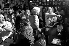 Danny Campbell, Lil Nasty Boy, center interacts with the crowd during a wrestling performance at Cozzy's Comedy Club Wednesday evening.