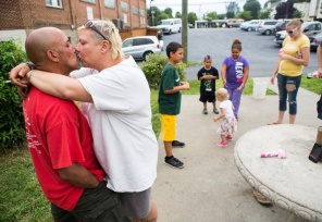 John and Constance Nettles share a kiss outside The Valley Mission on Aug. 8, 2015. The couple's moments of intimacy are brief as John says they are expected to refrain from public displays of affection inside the shelter walls.