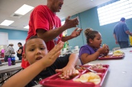 John Nettles serves dinner to his children, Christian Nettles, 5, left, and Olivia Nettles, 7, in the cafeteria at The Valley Mission on Aug. 8, 2015. ÒI want a better life for them,Ó said John, ÒI never thought this would happen to me.Ó