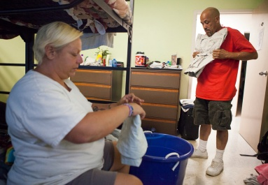 John and Constance Nettles pack up clothes as they prepare to leave The Valley Mission after John was offered a job out of state on Aug. 8, 2015.