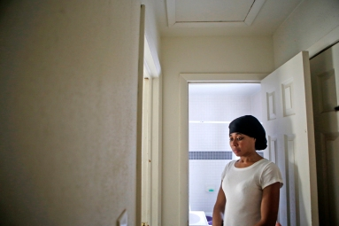 Kisha Johnson stands inside her Pinewood Heights home Wednesday afternoon. Smithfield is halfway through a redevelopment project to relocate residents in the neighborhood and raze the houses to develop an industrial park.