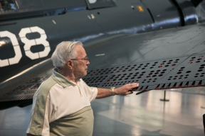 "George ""Art"" Plumador, 91, of Malone, N.Y., examines the restored Curtiss SB2C Helldiver he flew during World War II at the Smithsonian National Air and Space Museum's Steven F. Udvar-Hazy Center in Chantilly, Va., on Monday, August 10, 2015. Plumador served as a radio operator and gunner aboard the dive bomber."