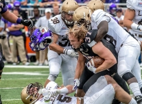 James Madison University r-senior Deane Cheatham (37) looses his helmet as he gets taken down by the Lehigh defense during their game at JMUÕs Bridgeforth Stadium on Saturday, September 12, 2015.