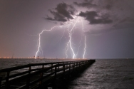 HM Environment/Nature: Jonathon Gruenke, Daily Press--Lightning flashes over the James River as severe thunderstorms move through Hampton Roads Tuesday evening.