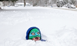 2nd PLACE FEATURE: Rob Ostermaier, Daily Press--Dolton McCurry in his Leonardo Teenage Mutant Ninja Turtles hoodie plays in the snow in front of his home on in Newport News. This is the second unusually large snowstorm to hit the area this winter.