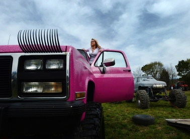 3rd PLACE FEATURE PICTURE STORY: Jay Diem, Easter Shore News---Baylee Hart steps up in her truck, which has matching eyelashes, to look over the mud hop course before the start of the Muddin' at the Moose event on Saturday, April 11, 2015. Hart would race in one run at the event before switching gears to attend her senior prom that night at nearby Broadwater Academy.