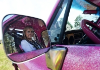 Baylee Hart, 18, bites her lip as she patiently waits for her turn to race in the Muddin' at the Moose mud hop on Saturday, April 11, 2015. Hart began racing in mud hop events at age 16 and is often one of a few female drivers in the racing field.