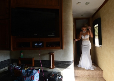 Baylee Hart dances after getting dressed in the camper where she prepared for her senior prom.