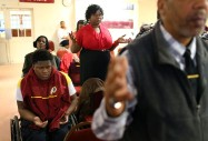 Edward Miller, (17 in 2014) left, prays with his mother, Lawanda Booker, standing next to Edward, during a church service at Crusade for Christ Christian Church Ministries in Richmond on Sunday, March 2, 2014. Edward often recites the note from his sister, Shakiria Miller, ÔGod gives his hardest battles to his strongest warriors.Õ ÓThatÕs what got me through physical therapy, those hard days and me passing out and stuff like that. ThatÕs what got me through that hard time,Ò Edward said of the note.