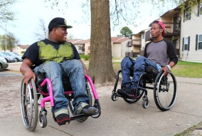 Edward, left, and Andre Seabrook, show off what they can do with their wheelchairs as Edward visits his friend, Andre, in Richmond on Monday, April 14, 2014. They met each other at VCU rehabilitation center as they both were shots on the same day but not related crimes, which caused paralysis for both from their waist down. ÒWhen I heard his story, it made me feel better about my story. So I wonÕt be the only one going through my situation, ÒEdward said of Andre.