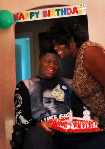 Edward Miller and his mom, Lawanda Booker, share a smile on Edward's 18th birthday at their home in Richmond on Jan. 31, 2015. Lawanda said she is grateful for God that Edward made his 18th birthday after all of struggles after the shooting. Booker said, ÒToday is a day of celebration for me and Edward.Ó