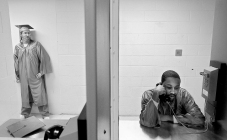1st PLACE GENERAL NEWS: Rob Ostermaier, Daily Press---Newport News inmate Gregory Washington talks on the phone at the jail annex as he prepares for a GED graduation ceremony. Three inmates participated in the ceremony inside the jail.