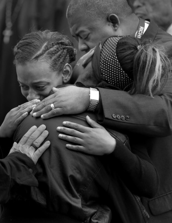 3rd PLACE GENERAL NEWS: Daniel Min, Times-Dispatch---Shaqwanna Boisseau, facing, comforts her cousin, Kalesha Jones, 11, best friend of Amiya Moses, during a vigil. Amiya, the 12-year-old, was killed at her friend's apartment.
