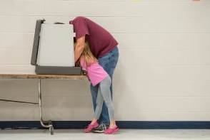 HN GENERAL NEWS: Daniel Lin, Daily News-Record---Bryan Kiracofe, of Briery Branch, casts his vote on election day with some help from his daughter Chloe, 6, at the Ottobine Elementary School voting location.