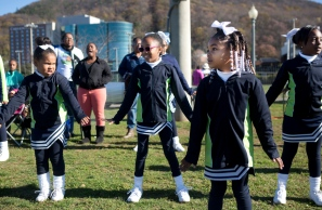 From left to right: Tamari Merchant, Anika Battle, From left to right: Tamari Merchant, Anika Battle, Genesis Adams and Kennedy Helm cheer for their team, the Wolverines, on Saturday, Nov. 14, 2015.