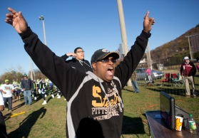 Dietrich Bundick, a coach with the AAU Virginia Wolverines, cheers as he watches his team make plays against the Richmond Eagles at River's Edge Sports Complex on Saturday, Nov. 14, 2015.