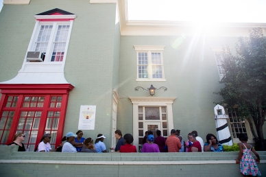 A crowd gathers outside of the Lighthouse before they open on a Thursday during their food bank distribution. The Lighthouse gives food out twice a month, once from the government provided food and one from their food pantry.