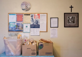 Boxes of food wait to be shared at the Lighthouse. Some days Lighthouse receives up to 46 pounds of bread donations from local businesses as part of the Feeding American program..