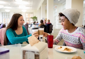 Sweet Briar seniors Citlali Molina (left) and Nadirah Abdus-Sabur toast their coffee's during lunch on campus. The two engineering students both had found alternative colleges to attend before it was announced that Sweet Briar College would be reopening.