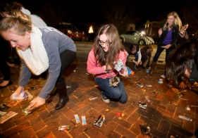 "Sweet Briar College students gather up snacks at the finals week tradition of ""scream night."" On Friday night the students gather outside the Chapel on campus. When the bell rings at 10 p.m. the students scream for the duration of the bells before being released to gather the snacks, kicking off finals week."