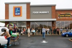 A new Aldi store opened Thursday morning to a crowd of hundreds at Crossroads Mall in Roanoke. The discount chain is also planning to open a store in Lynchburg and perhaps another in Christiansburg.