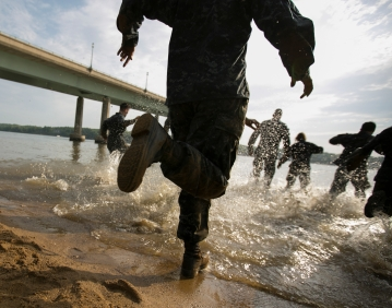 3rd PLACE NEWS PICTURE STORY: Mike Morones, Military Times---Plebes run to the Severn River to wash off during the annual Sea Trials exercise at the U.S. Naval Academy in Annapolis, Md., on Tuesday, May 12, 2015. The event, modeled after the Marine Corps' Crucible and Navy's Battle Stations events, runs over 14 hours and tests the plebes' physical and mental endurance.