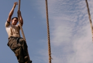 Plebe Jack Herold of Chicago climbs a rope at the end of the obstacle course during the annual Sea Trials exercise at the U.S. Naval Academy in Annapolis, Md., on Tuesday, May 12, 2015. The event, modeled after the Marine Corps' Crucible and Navy's Battle Stations events, runs over 14 hours and tests the plebes' physical and mental endurance.