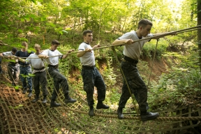 Plebes cross a rope bridge during the annual Sea Trials exercise at the U.S. Naval Academy in Annapolis, Md., on Tuesday, May 12, 2015. The event, modeled after the Marine Corps' Crucible and Navy's Battle Stations events, runs over 14 hours and tests the plebes' physical and mental endurance.