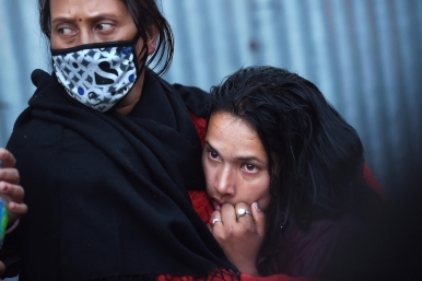 2nd PLACE NEWS PICTURE STORY: Matt McClain, Washington Post---Babita Bhandani, right, mourns her brother, an earthquake victim at Pashupatinath Temple on Wednesday April 29, 2015 in Kathmandu, Nepal. A deadly earthquake there killed thousands.