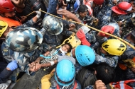 Earthquake survivor, Pemba Tamang, 15, is carried away after Fairfax County emergency personnel working with USAID Disaster Assistance Response Team assisted in the effort to save Tamang from the rubble on Thursday April 30, 2015 in Kathmandu, Nepal. A deadly earthquake in Nepal has killed thousands. Tamang was buried in the rubble for several days.