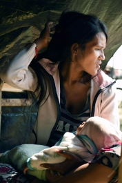 Widowed and displaced by the earthquake, Minu Nepali, 23, holds her unnamed youngest son as she now lives in a tent encampment on Tuesday May 05, 2015 in Kathmandu, Nepal. Her husband was killed in the earthquake.