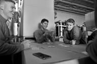 AD-3 Jonathan Woodell, left, Amean Ruben Morones, center, Amean Chase Allen, right, and other USS George Washington service members play cards Wednesday afternoon in the hanger bay. The USS George Washington is returning to Naval Station Norfolk following it's deployment in Japan Thursday December 17, 2015.