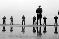 Sailors stand on the flight deck of the USS George Washington as the aircraft carrier begins to arrive at Naval Station Norfolk Thursday morning December 17, 2015.