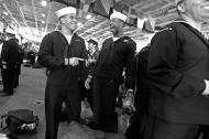 E-3 Terin Lillard, left, and E-3 Darell Reddick, center, laugh while waiting to leave the USS George Washington after the aircraft carrier arrived at Naval Station Norfolk Thursday morning December 17, 2015.
