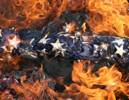 1st PLACE PICTORIAL: Heather Rousseau, Roanoke Times---A flag is burned along with other retired flags during the William Byrd High School annual flag retirement ceremony on Wednesday, Nov. 11. The ceremony took place on the stadium field and people were welcome to bring flags for the JROTC to properly retire.